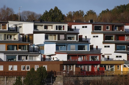storied: new modern architecture at frozen riverside in winter