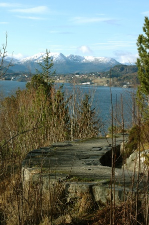 hiking footpath with view to high mountains and ocean in Kristiandsund, Norway