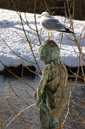 Sculpture of peeing boy with seagulls in park of Kristiansund, Norway