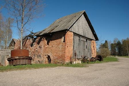 Abandoned damaged old brick house against blue sky Stock Photo - 13596018