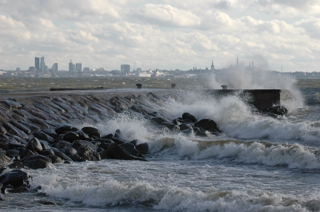 Storm on sea. Estonian capital Tallinn at background
