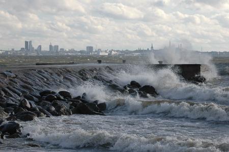 Storm on sea. Estonian capital Tallinn at background