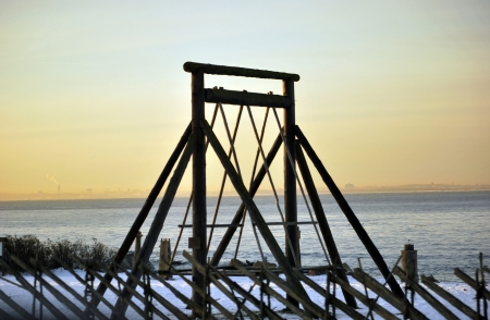 Lone big historical wooden swing at seaside winter photo
