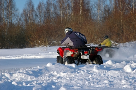 all terrain vehicle in motion at winter Standard-Bild