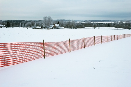 red fence at winter landscape Stock Photo - 17524622