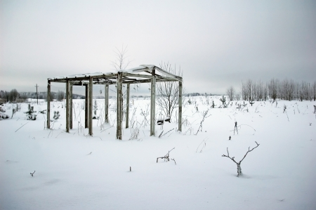 wooden diy homemade greenhouse skeleton with snow in winter photo