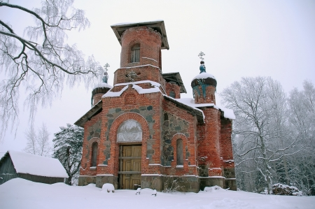 old abandoned orthodox cathedral in Maaritsa, Estonia and tree branches Stock Photo - 17524686