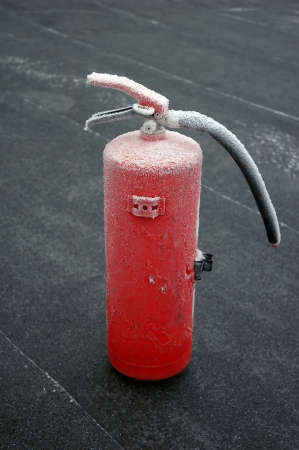 frosted fire extinguisher on floor Stock Photo - 17878721