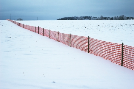 red fence on winter landscape Stock Photo - 17878714