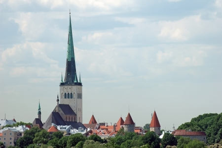 St. Nicholas Church, (Niguliste) Museum in Tallinn, Estonia with Old City wall towers and Fat Margaret (Paks Margereeta) photo