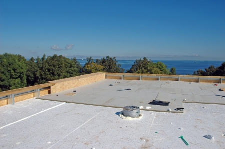 flat roof: new roof construction at seaside Stock Photo