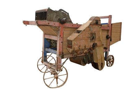 threshing: mobile horse threshing machine isolated on white. clipping mask