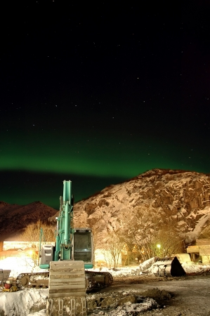 Aurora borealis  northern lights  and lots of stars around the constellation  Big Dipper  and excavator  photo