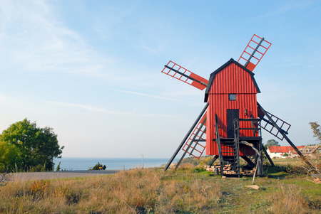 renovated windmill with trees at ?land, Sweden