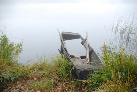 drowned: old wooden drowned boat on lake coast Stock Photo