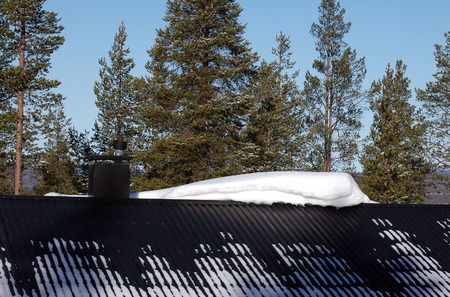 snowdrift on the roof at winter photo