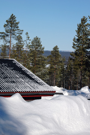 snowdrift and snow on the roof at winter photo