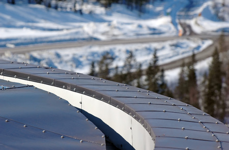 rooftiles: rounded tin roof with screws at winter Stock Photo