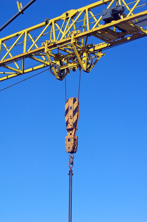poling: yellow industrial crane isolated on blue sky