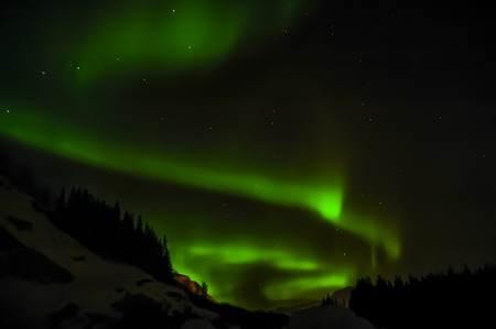 ionosphere: northern lights in sky at Norway Stock Photo
