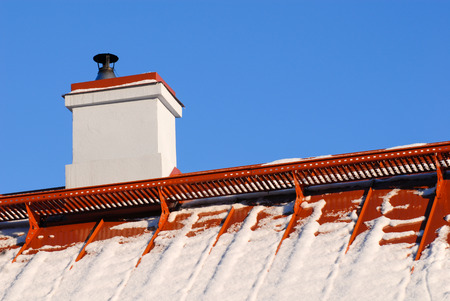 roof ridge: snow on the roof at winter Stock Photo