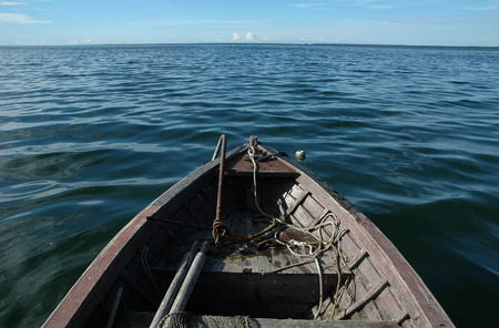 old wooden fishing boat on sea Stock Photo