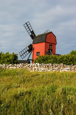 sweden resting: Windmill On Background With Road And Wild Flowers In Oland, Sweden