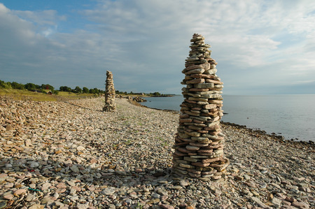 Rock Piles At A Clear Blue Sky By The Coast Of The Swedish Island Oland Stock Photo