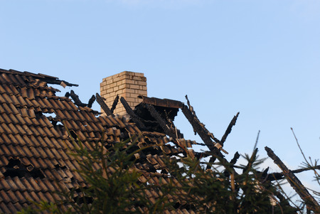 roof of the burned house Stock Photo