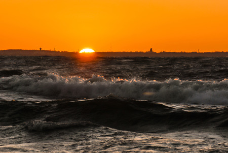 sunset on stormy Baltic sea Stock Photo
