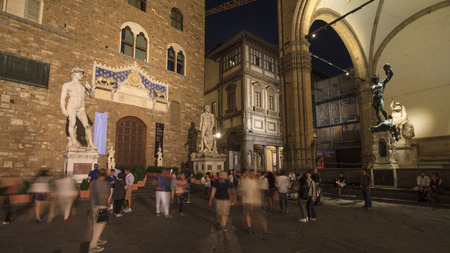 signoria square: People walking at night around Piazza della Signoria, the main square in the famous capital of Tuscany, Italy