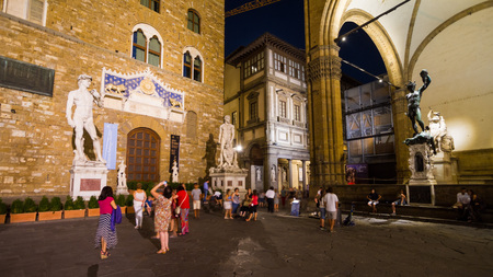 pilasters: Florence, September 2016: Tourists in Piazza della Signoria, the famous square in front of Palazzo Vecchio, on September 2016 in Florence