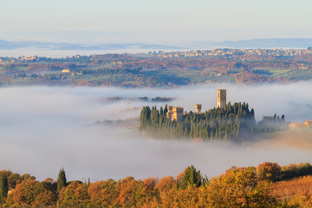 San Casciano Val di Pesa, November 2016: Abbey of Passignano and vineyard landscape in autumn with fog, on November 2016 in San Casciano Val di Pesa, Italy
