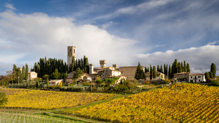 Chianti, November 2017:  Vineyard landscape with characteristic Church, tower and cypresses, on November 2017 in Chianti, Tuscany, Italy