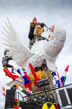 Viareggio, January 2018:  Kim Jong-un and Dove of peace caricature in carnival parade of floats and masks, made of paper-pulp, on January 2018 in Viareggio, Tuscany, Italy