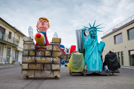 Viareggio, January 2018: Donald Trump and Statue of Liberty caricature in carnival parade of floats and masks, made of paper-pulp, on January 2018 in Viareggio, Tuscany, Italy