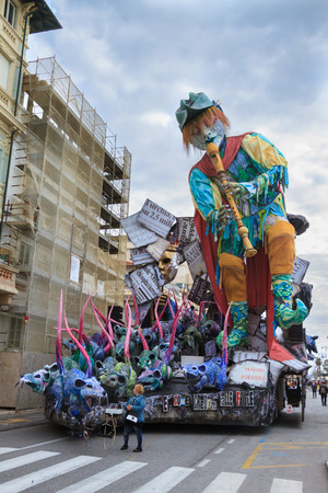 Viareggio, January 2018: The Pied Piper of Hamelin with magic flute and mice on carnival parade of floats and masks, made of paper-pulp, on January 2018 in Viareggio, Tuscany, Italy