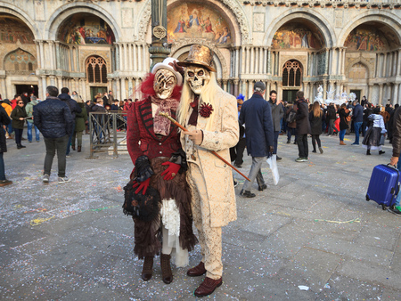 Venice, February 2017:  Costumed people during the famous venetian Carnival , on February 2017 in Venice, Italy