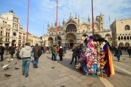 Venice, February 2017: Reflections of the tourists on the windows of the Venetian carnival mask shops on February 2017 in Venice, Italy Sajtókép