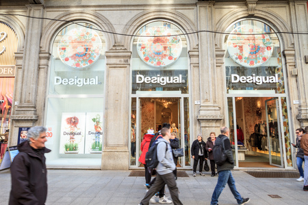 Milan, March 2018: Shop window of Desigual  in Shopping Street of fashion and design capital of the world, on March 2018 in Milan, Italy, Europe Sajtókép