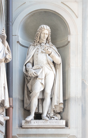 Statue of Pier Antonio Micheli, on the facade of the Uffizi gallery. Florence, Tuscany, Italy Editorial