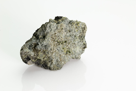 The olivine is a magnesium iron silicate mineral, from Vesuvius volcano, isolated on a white background, Naples, Italy Stock fotó