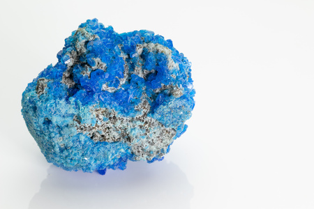 Covellite (covelline): rare blue copper sulfide mineral with the formula CuS, from Vesuvius volcano, isolated on a white background, Naples, Italy