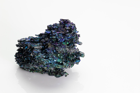 Silicon carbide (carborundum),  shiny and colorful mineral stone from Vesuvius volcano isolated on a white background, Naples, Italy