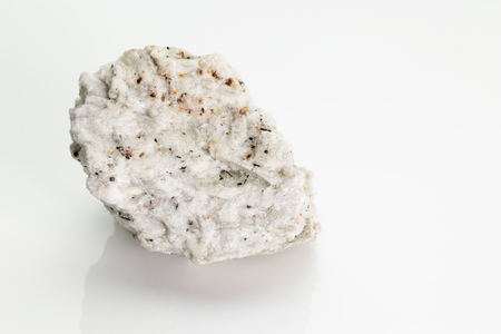 Sanidine: high temperature form of potassium feldspar with a general formula K(AlSi3O8), from Vesuvius volcano isolated on a white background, Naples, Italy