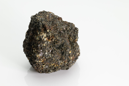 The mica black is group of sheet silicate (phyllosilicate) minerals, from Vesuvius volcano isolated on a white background, Naples, Italy Stock fotó