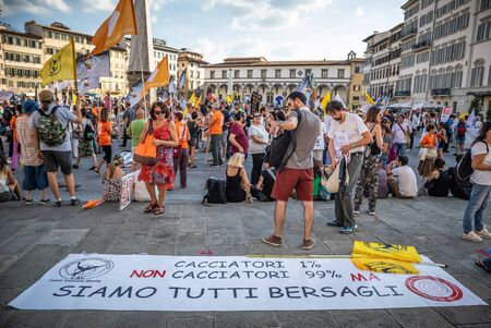 Florence, September 15 2018: Group of animal activists protest marching on the road against hunting, with signboard and slogan, on 15 September 2018 in Florence, Italy
