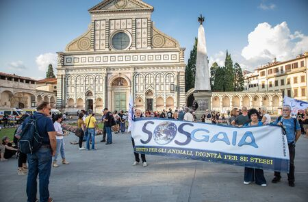 Florence, September 15 2018: Group of animal activists protest marching on the road against hunting, with signboard and slogan, on 15 September 2018 in Florence, Italy Stock fotó - 131496997