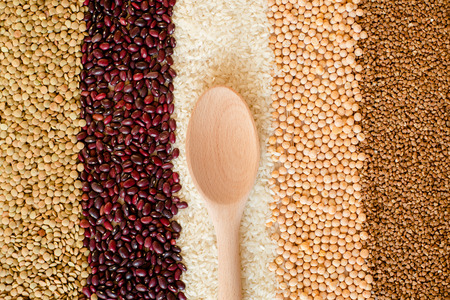 seeds of various: Grain and beans striped background. Various types of seeds. beans, peas, buckwheat, lentils, rice. healthy food and diet concept. Grain and beans background. top view