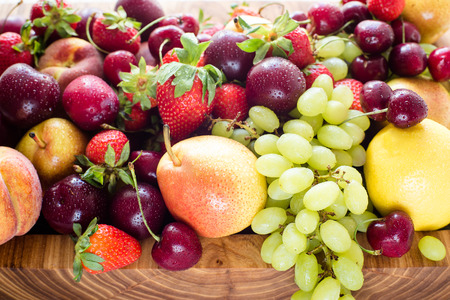 mixed fruits: Fresh mixed fruits and berries.Fruits, berries background.Healthy eating, dieting.Love fruits, clean eating. Grape, lemons, apricots, peaches and pears and strawberies and cherry.colorful background